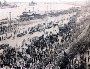 People Gathered along the Bund celebrating victory in Shanghai