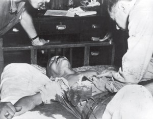 Immediately after his suicide attempt, Tōjō Hideki receiving life-saving treatment at SCAP Hospital in Tokyo, 8 September 1945