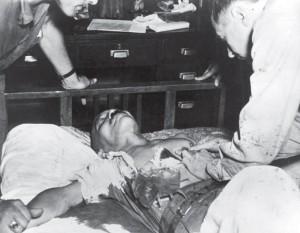 Immediately after his suicide attempt, Tōjō Hideki receiving life-saving treatment at SCAP Hospital in Tokyo, 8 September 1945