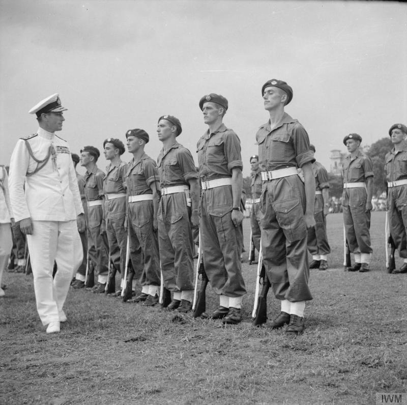 Supreme Commander of the South East Asian Command, inspecting men of the Royal Air Force Regiment outside the Municipal Buildings in Singapore on 12 September, hours before Japan's Southern Expeditionary Army surrendered. A string of surrenders in Malaya occurred both before and after this main event.