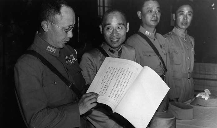 inspects the Japanese surrender document in Nanking [World War II Database, Peter Chen](http://ww2db.com)